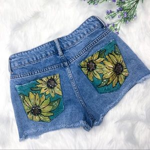 Hand painted sunflower jean cutoff shorts